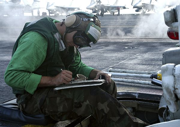 Aviation Boatswain's Mate Equipment Third Class Carl Bogenschneider, of Medford, Ore., prepares for flight operations on the flight deck of the nuclear-powered aircraft carrier USS Enterprise (CVN-65).